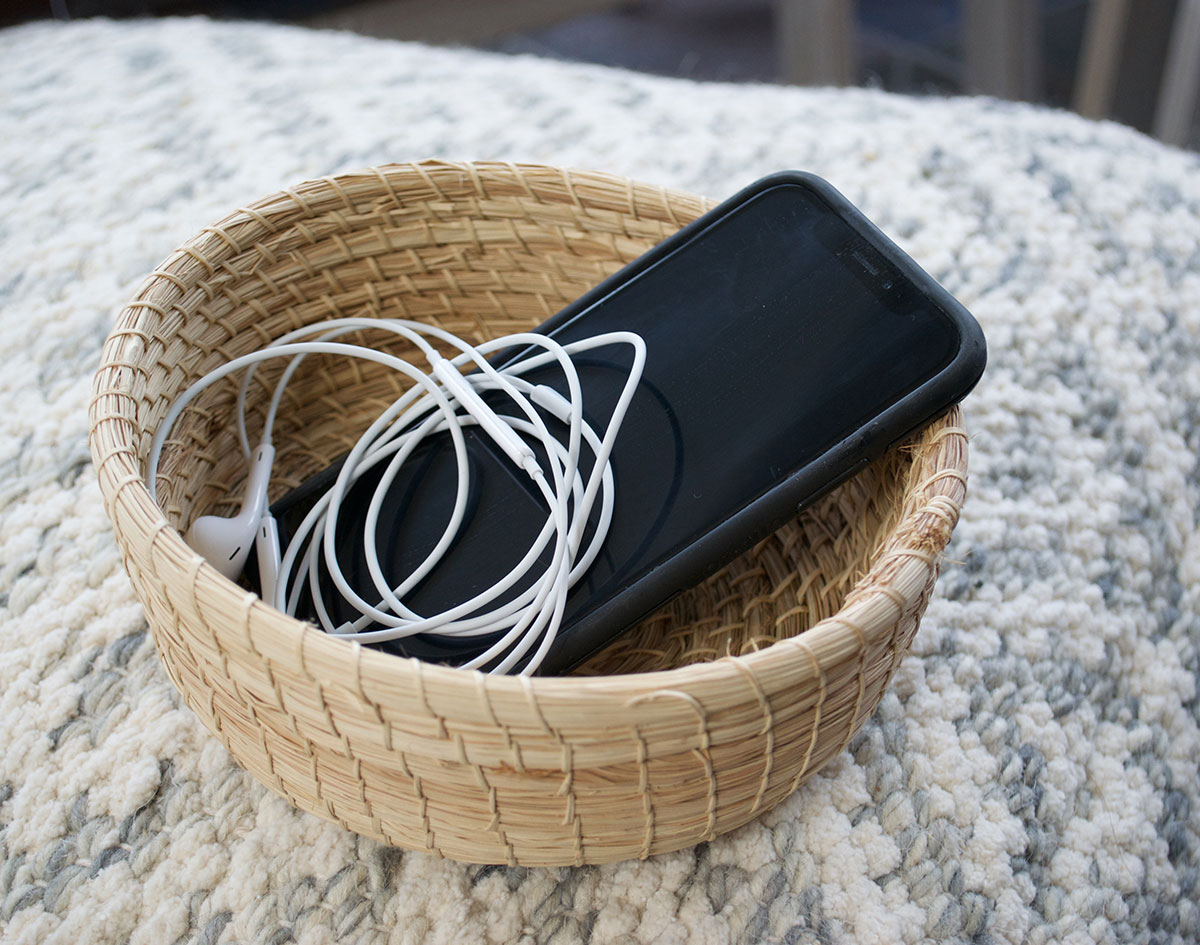 iPhone and headphones in a basket