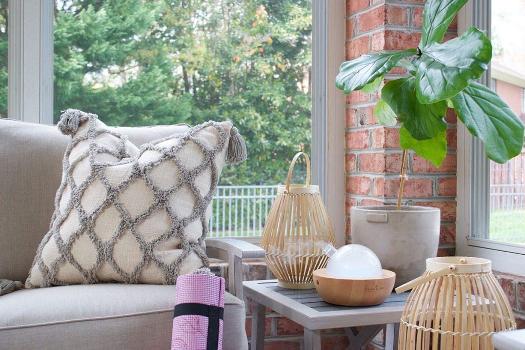 patio furniture with yoga mat and oil diffuser