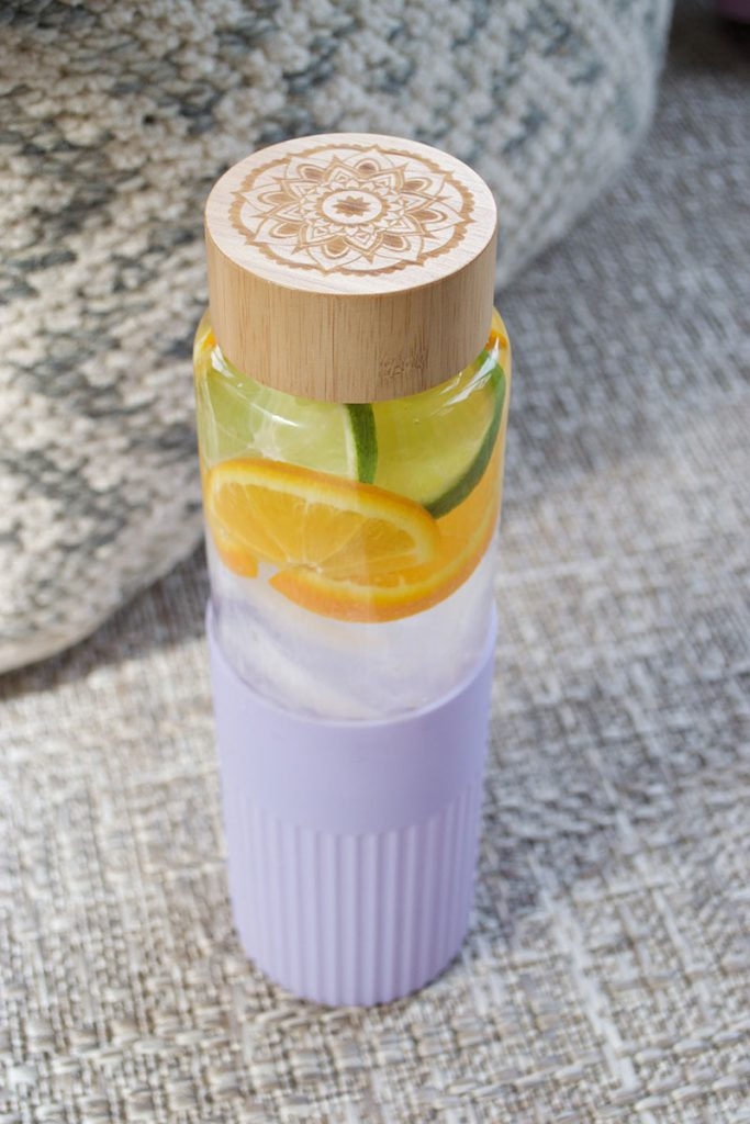 water bottle with orange and lime
