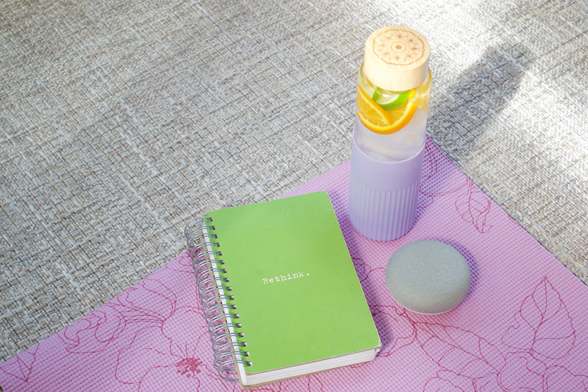 water bottle and journel on a yoga mat