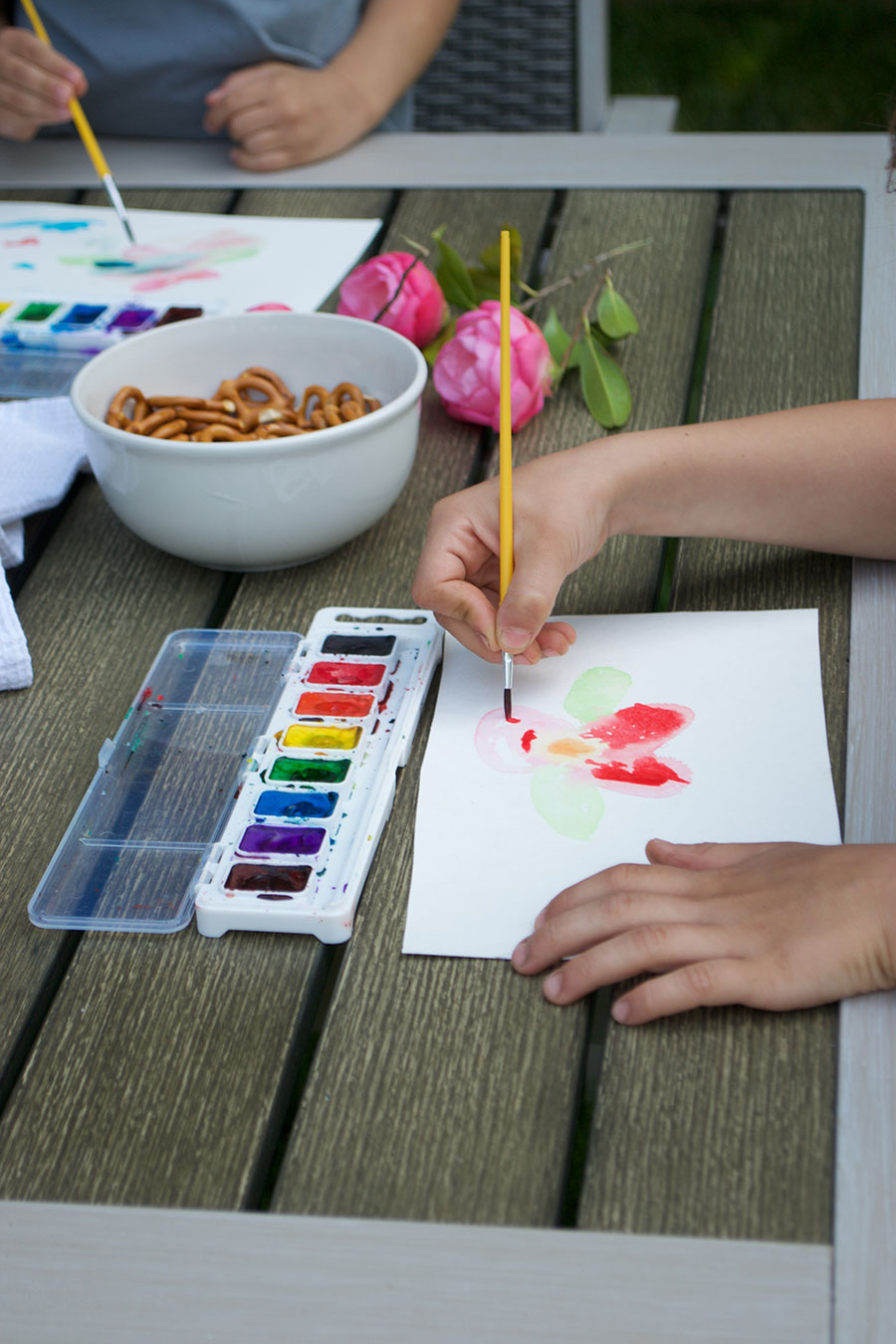 detail of child's watercolor painting on patio table
