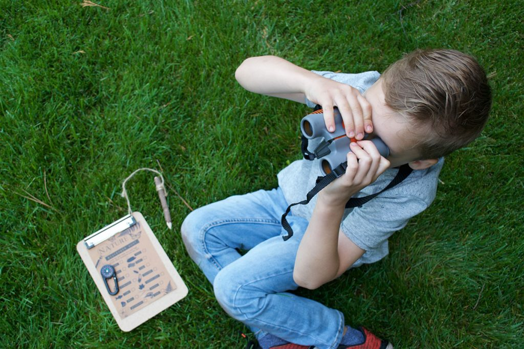 boy outside with binoculars