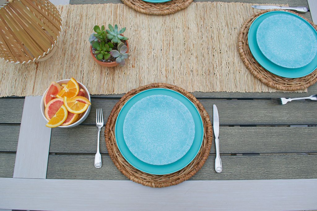 patio table top with aqua blue plates