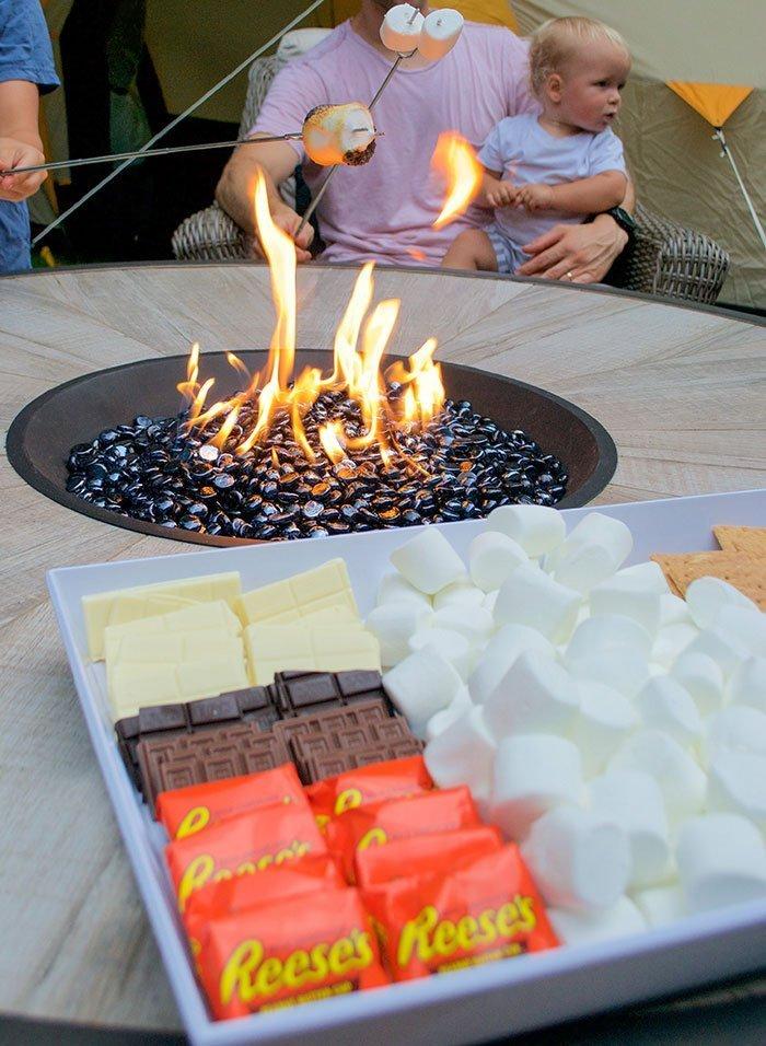 making smores on backyard patio firepit