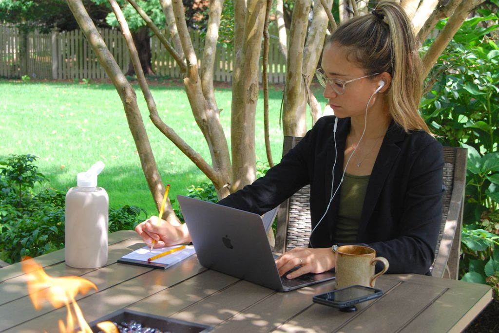 woman working on outdoor patio table