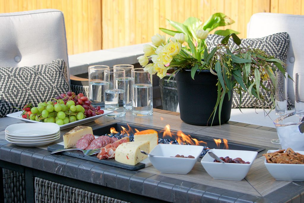 flowers on firepit table with party food
