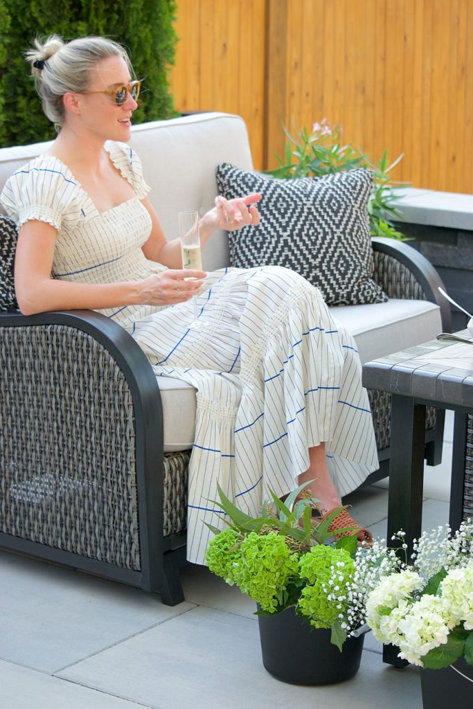 woman sitting on outdoor patio with flowers