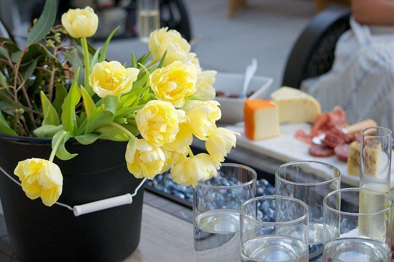 yellow flower arrangement on outdoor patio