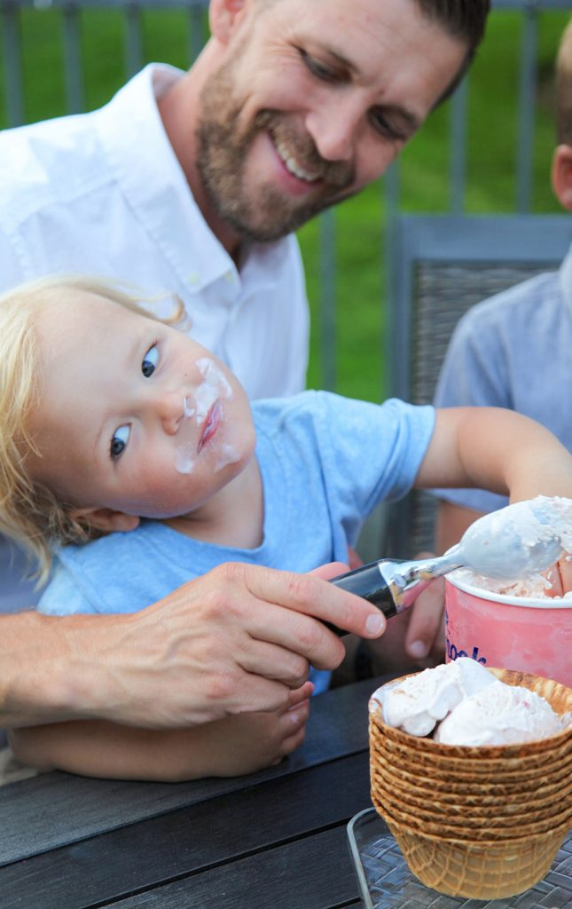 Father with young son who has icecream on his face