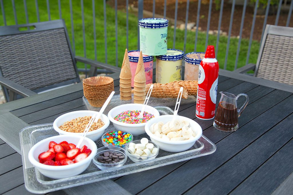 icecream and sundae toppings tray on patio table