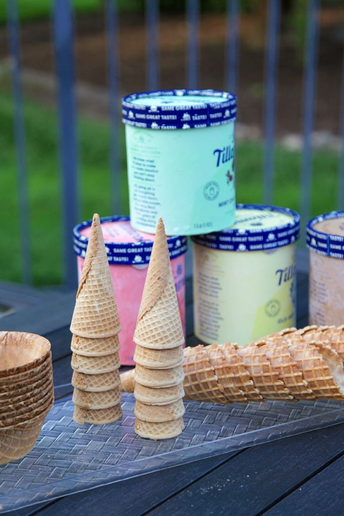 icecream with stacked cones and cone bowls on patio table