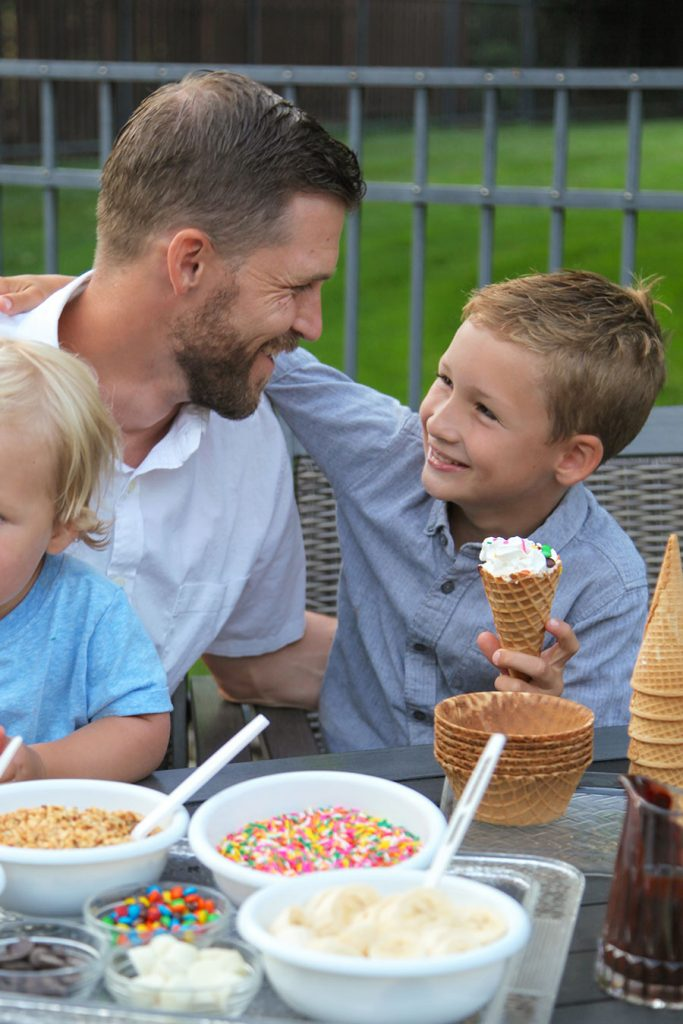 Son with icecream cone smiling at father