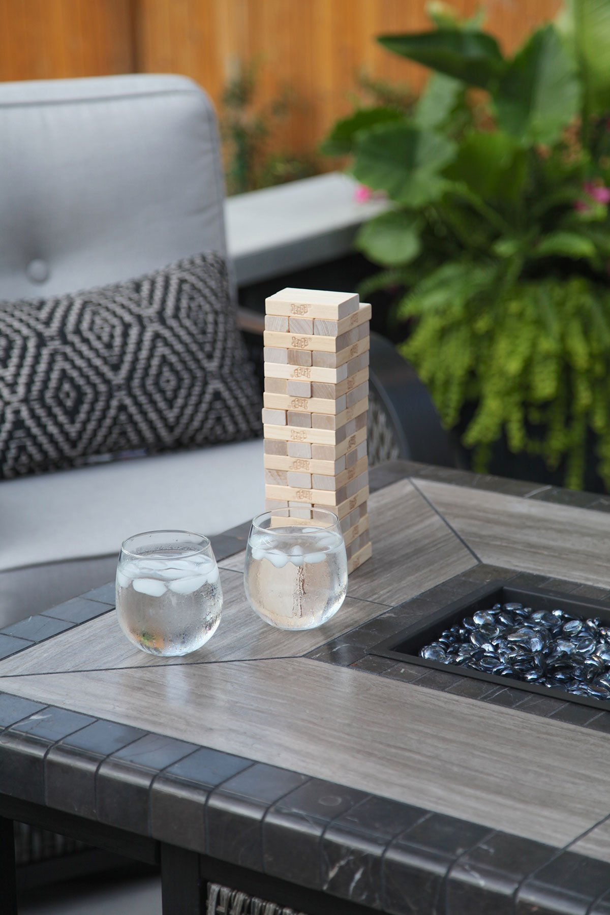 game and drinks on outdoor fire pit table