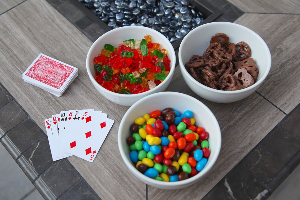 goodie bowls and cards on outdoor fire pit table